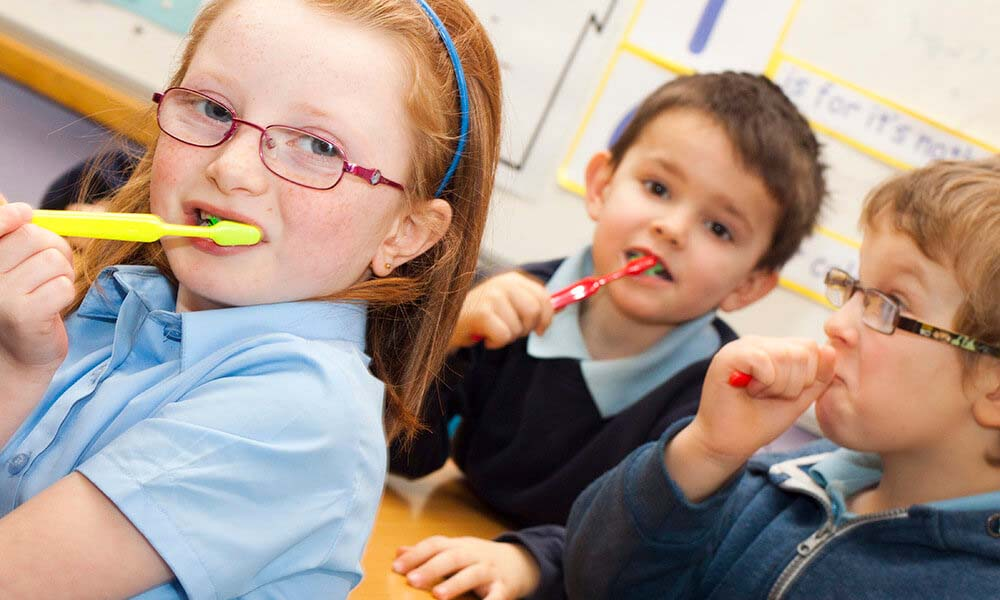 School children brush their teeth and learn about good oral health with Simplyhealth's Teeth team partnership