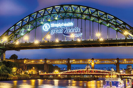 Simplyhealth Great North Run logo featuring on the Tyne Bridge which links Newcastle upon Tyne and Gateshead