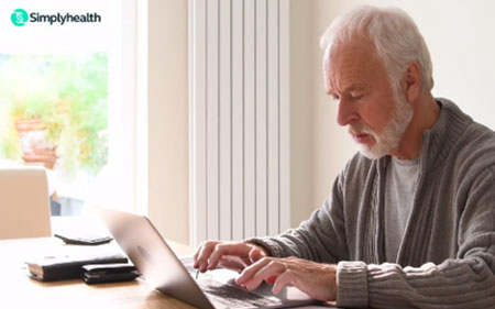Man typing on laptop at home