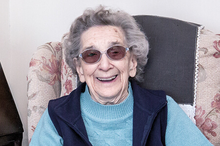 Smiling elderly lady representing Simplyhealth's charitable giving to health and wellbeing focused charities locally and across the UK