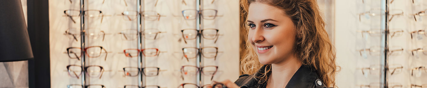 lady looking at glasses in opticians