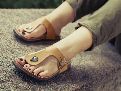 Woman wearing sandals with arch support