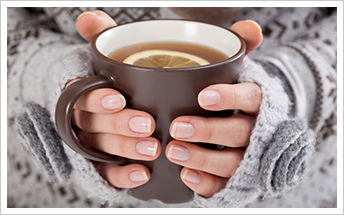 Hands holding warm drink