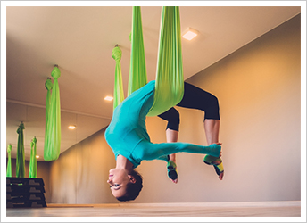 Woman practising Anti gravity yoga
